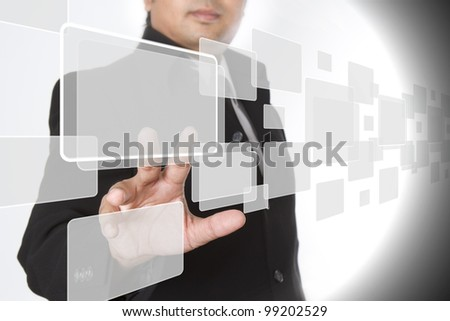 businessman pushing on a touch screen interface