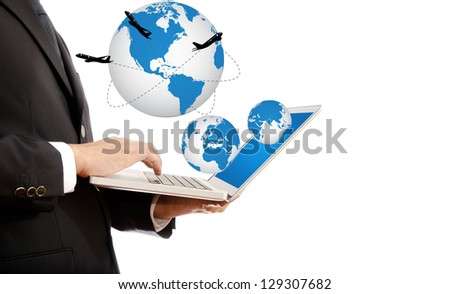 Businessman pushing on laptop keyboard for Business Concept with World Map Globe. with airplane around the globe.