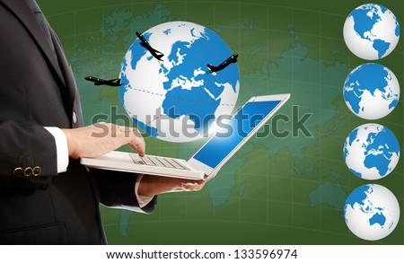 Businessman pushing on laptop keyboard for Business Concept with World Map Globe with airplane around the globe