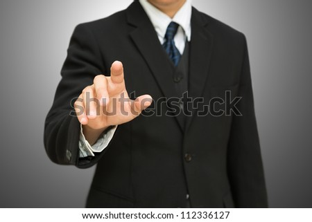 Businessman pushing on the whiteboard with clipping path
