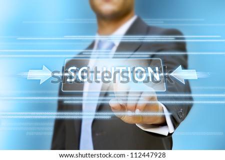 Businessman pushing solution button concept
