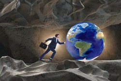 Businessman pushing the world in challenge concept