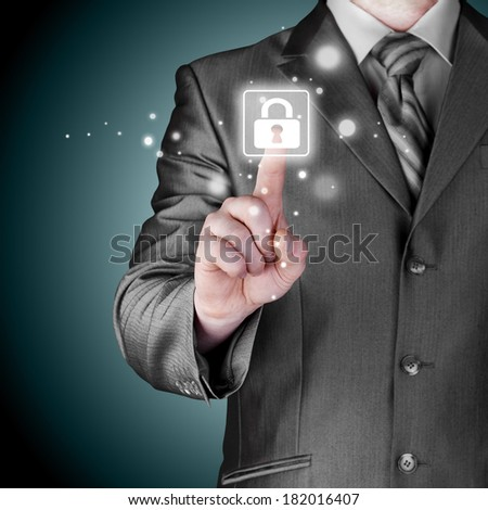 Businessman pushing virtual security button #182016407