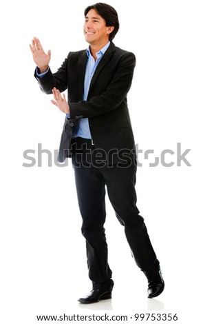 Businessman pushing with his hands - isolated over a white background - stock photo