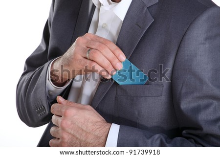 Businessman puting credit card in his pocket, close up - stock photo