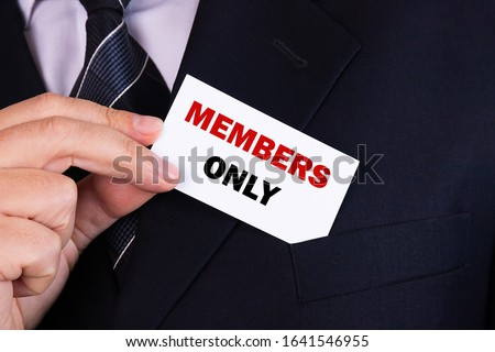 Businessman puts a card with text MEMBERS ONLY in his pocket Stock photo ©