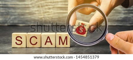 Businessman puts wooden blocks with the word Scam. Fraudulent investment project. Illegal plan to get money. Cheating people. Raw deal. Financial Pyramide. Hacker attack Stock photo ©