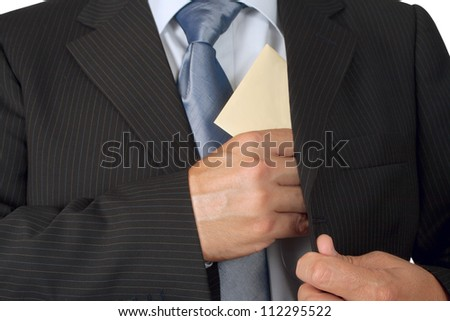Businessman putting an envelope in his jacket pocket - concept of bribe