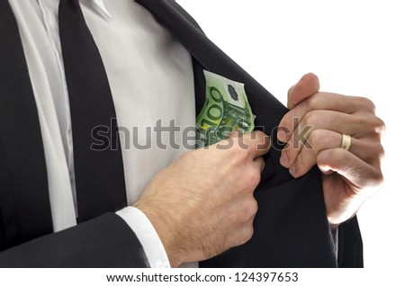 Businessman putting money in his jacket pocket. Concept of bribe. - stock photo