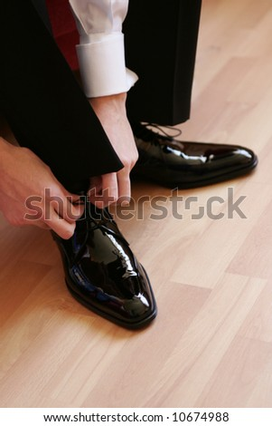 Businessman putting on shoes