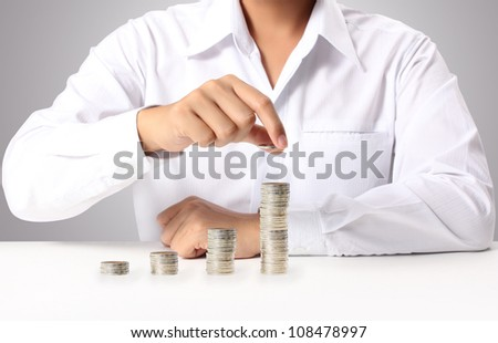 Businessman putting the coins