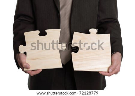 Businessman putting together a big puzzle, concept for solution or strategy