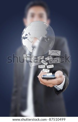 Businessman putting touch screen mobile phone with mail globe.