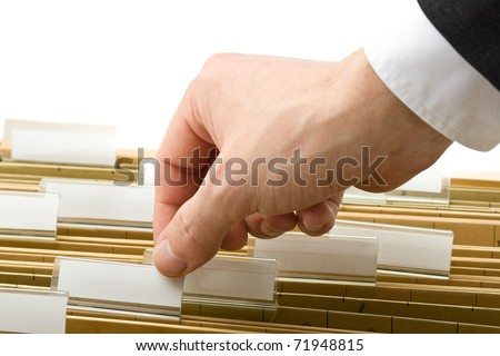 Businessman reaching for office folder in drawer