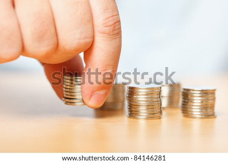 Businessman reaching for pennies, financial crisis concept