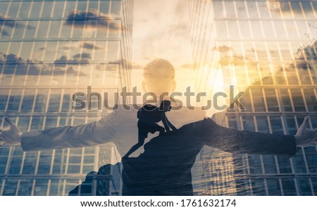 Businessman reaching for success and overcoming obstacles concept.  Stock photo ©