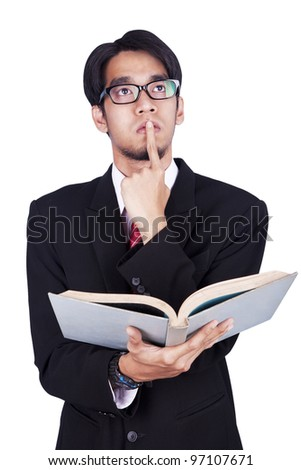 Businessman reading a book and thinking shot in studio isolated over white