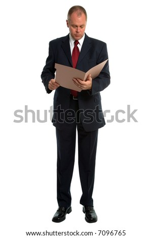 Businessman reading a file, isolated on white.
