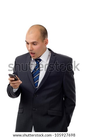 Businessman reading a text message on his smartphone