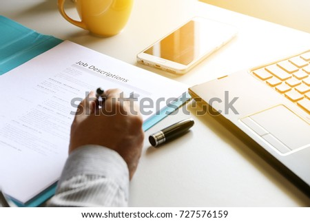 businessman Reading job description paper In office.