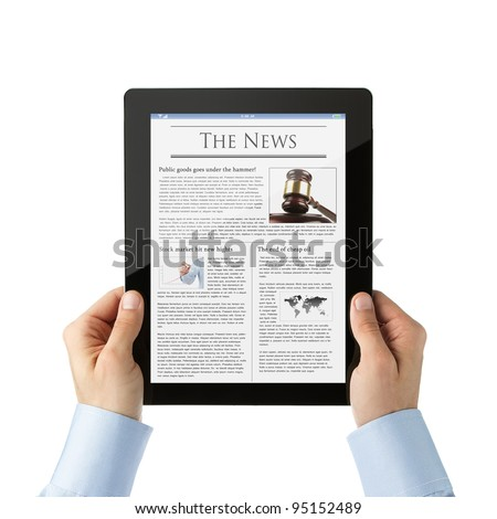 Businessman reading news at digital tablet