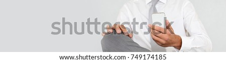 Businessman reading short message on mobile phone - banner template web