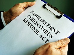 Businessman reads families first coronavirus response act FFCRA.