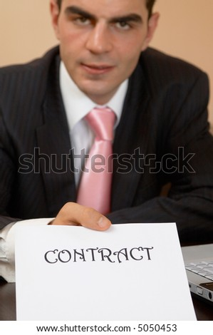 businessman ready to sign contract, shallow dof - stock photo