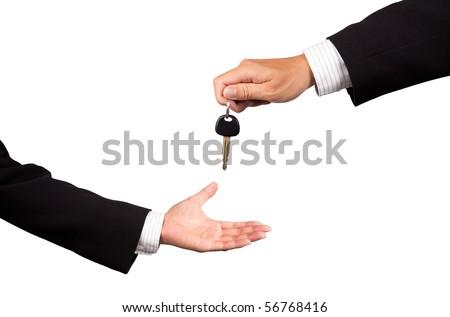 businessman receiving car key from salesman