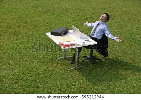 Businessman relaxing at office desk
