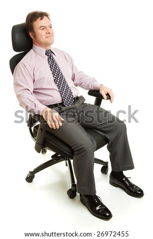 Businessman relaxing in ergonomic office chair.  Isolated on white.