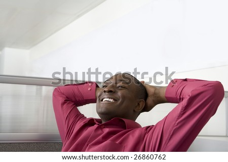 Businessman relaxing in office cubicle