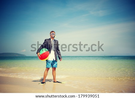 Businessman Relaxing On a Beach with Ball