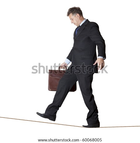 Businessman rope-walker. Isolated on white background