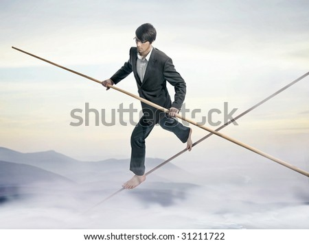 Businessman running a tightrope