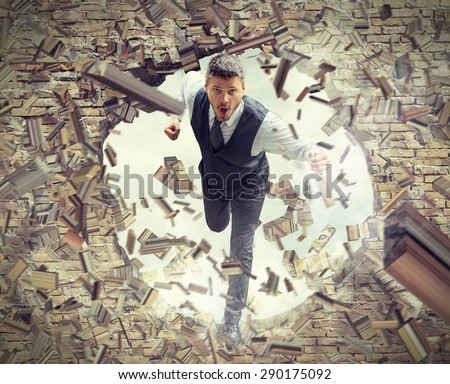 Businessman Running and Breaking Wall ストックフォト ©
