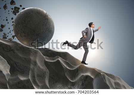 Businessman running away from falling rolling stone Stock photo ©
