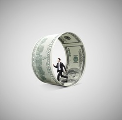 businessman running in money wheel  on gray background