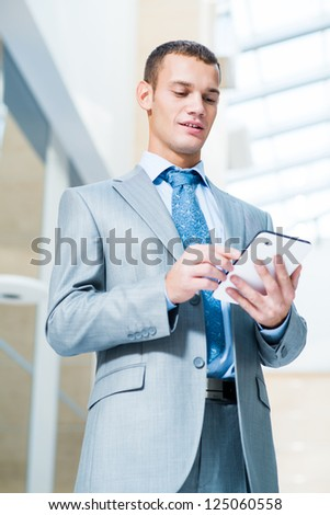 businessman running in the Tablet PC in the office
