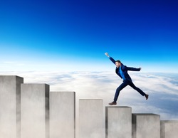 Businessman running on the concrete stairs blocks. Concept of achieving your goal.