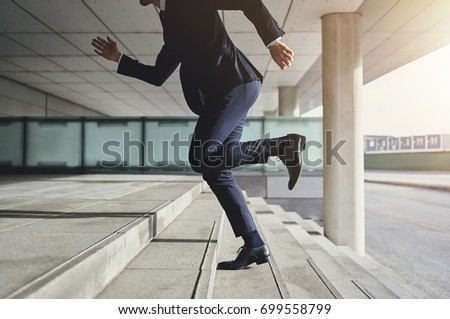 Businessman running up the stairs  #699558799