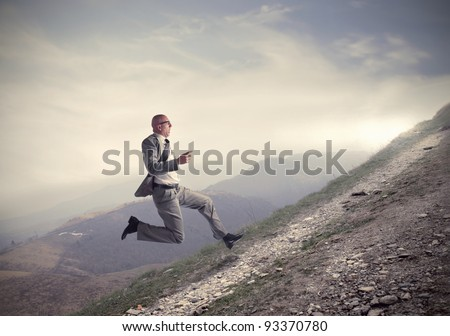 businessman running uphill