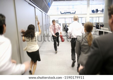 Businessman running with fire extinguisher