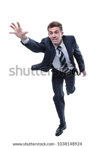 businessman runs forward stretching out his hand
