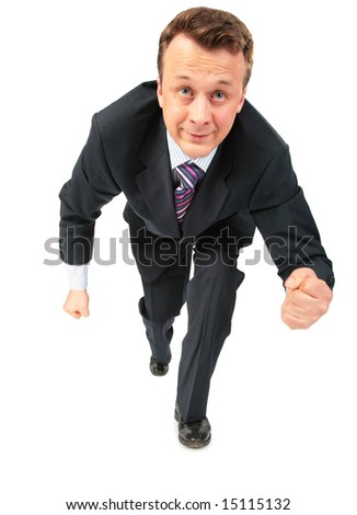 businessman runs having compressed fists