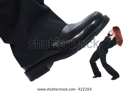 """Businessman's foot stepping on tiny business woman.  Metaphor for """"Crushing the Competition"""" """"Squashing the Little Guy"""" or for at work stress or power."""