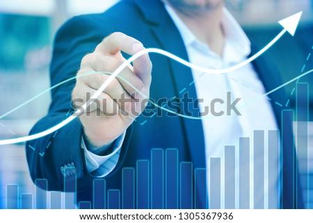 Businessman 's hand control trendline and volume chart