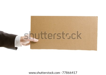 Businessman`s hand holding a blank cardboard sign