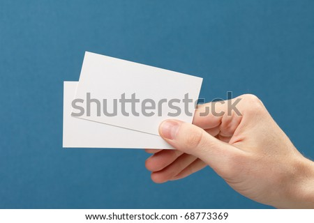 businessman\'s hand holding blank white paper business card