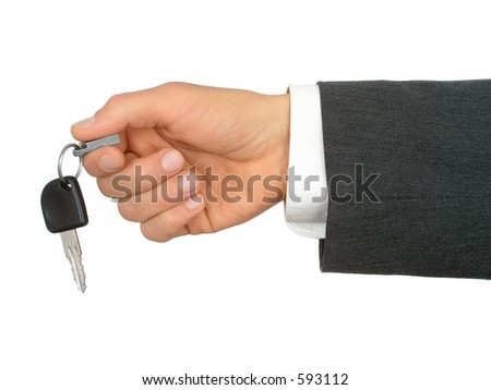 Businessman's Hand Holding Car Key